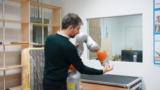 Professor Righetti working with robotic arm